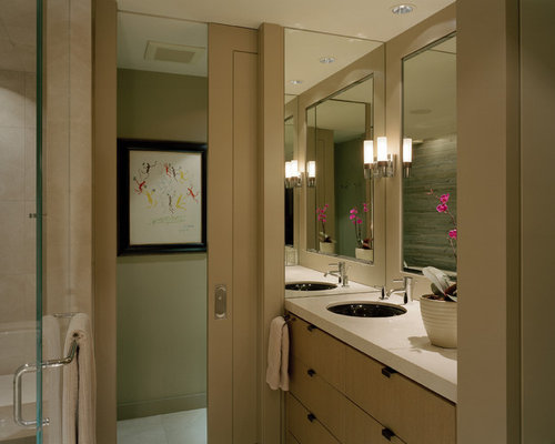 bathroom idea in seattle with an undermount sink flatpanel cabinets light