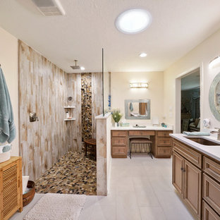 Inspiration for a mid-sized transitional master white tile and pebble tile porcelain tile and gray floor bathroom remodel in Houston with recessed-panel cabinets, light wood cabinets, a two-piece toilet, an undermount sink, quartz countertops, white countertops and beige walls
