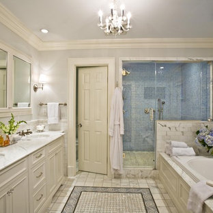 Large elegant master gray tile and stone tile bathroom photo in New York with an undermount sink, recessed-panel cabinets, white cabinets, gray walls and marble countertops