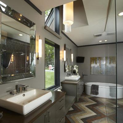 Freestanding bathtub - contemporary freestanding bathtub idea in Minneapolis with a vessel sink