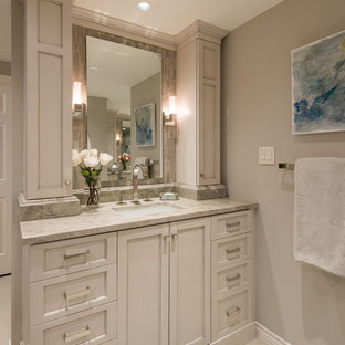 Example of a mid-sized transitional master gray tile and mosaic tile porcelain tile double shower design in Dallas with shaker cabinets, gray cabinets, a two-piece toilet, gray walls, an undermount sink, quartzite countertops and a hinged shower door