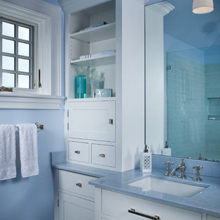 Inspiration for a mid-sized beach style master blue tile, green tile and glass tile pebble tile floor and beige floor corner shower remodel in Portland Maine with beaded inset cabinets, white cabinets, blue walls, a hinged shower door and blue countertops