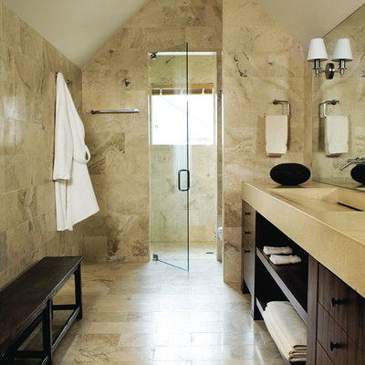 Example of a trendy beige tile and limestone tile alcove shower design in Atlanta with open cabinets, dark wood cabinets and an integrated sink