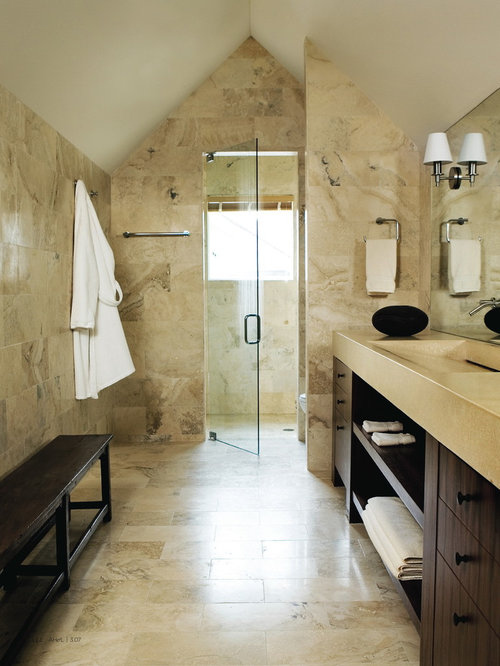 Example of a trendy beige tile and limestone tile alcove shower design in  Atlanta with open