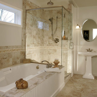 Example of a classic beige tile bathroom design in Portland with a pedestal sink and white cabinets