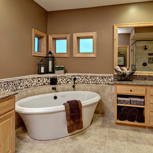 Inspiration for a contemporary freestanding bathtub remodel in Minneapolis with granite countertops
