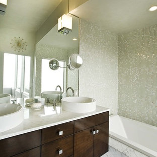 Bathroom - contemporary mosaic tile marble floor bathroom idea in San Francisco with marble countertops and a vessel sink
