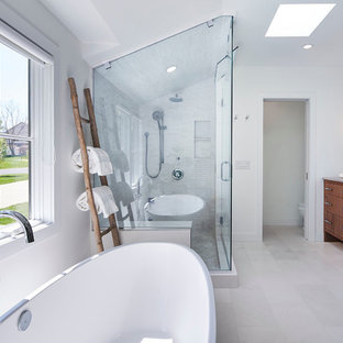Bathroom - mid-sized contemporary master beige tile, gray tile and marble tile white floor and marble floor bathroom idea in Minneapolis with flat-panel cabinets, medium tone wood cabinets, white walls, an undermount sink, a hinged shower door, a two-piece toilet and marble countertops