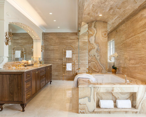 huge traditional master stone tile marble floor bathroom idea in san francisco with furniture like