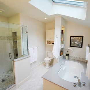 Elegant white tile alcove shower photo in Boston with an undermount sink, flat-panel cabinets, white cabinets, quartz countertops, an undermount tub and a two-piece toilet