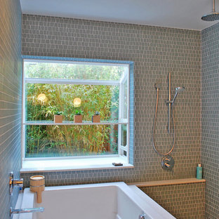 Inspiration for a contemporary bathroom in San Francisco with a japanese tub, green tile and mosaic tile.