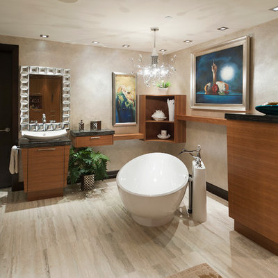 Freestanding bathtub - contemporary freestanding bathtub idea in Vancouver with a vessel sink