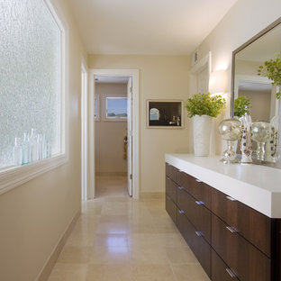 Bathroom - huge modern master beige tile and stone tile limestone floor and beige floor bathroom idea in Minneapolis with flat-panel cabinets, an undermount sink, solid surface countertops, white walls and dark wood cabinets