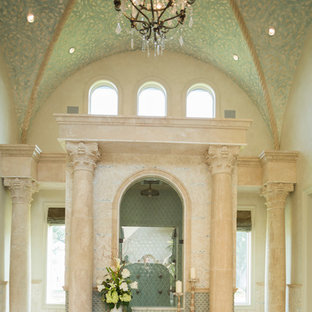 Design ideas for an expansive mediterranean bathroom in Houston with a built-in bath, a double shower and marble flooring.