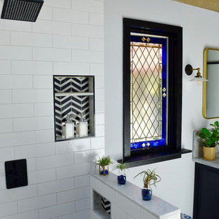 Example of a large transitional master black and white tile and ceramic tile marble floor and black floor bathroom design in Los Angeles with raised-panel cabinets, black cabinets, gray walls and marble countertops