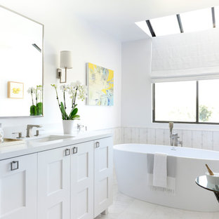 Mid-sized transitional master white tile and mosaic tile marble floor freestanding bathtub photo in Los Angeles with shaker cabinets, white cabinets, white walls, an undermount sink and solid surface countertops