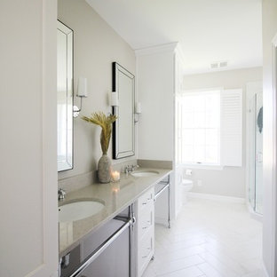 Alcove shower - mid-sized transitional master white tile and ceramic tile porcelain floor and yellow floor alcove shower idea in Other with shaker cabinets, white cabinets, a one-piece toilet, beige walls, an undermount sink, quartzite countertops and a hinged shower door