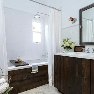 Ispirazione per una piccola stanza da bagno padronale chic con lavabo da incasso, ante lisce, top in superficie solida, vasca sottopiano, vasca/doccia, WC a due pezzi, piastrelle bianche, piastrelle diamantate, pareti bianche, pavimento in marmo e ante con finitura invecchiata