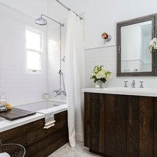 Farmhouse Bathroom by FOUR POINT Design+Construction Inc.