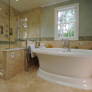 Design ideas for a traditional bathroom in Miami with a freestanding tub and travertine.