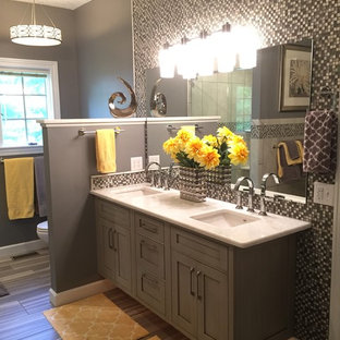 Mid-sized transitional master gray tile and mosaic tile ceramic floor bathroom photo in Other with an undermount sink, gray cabinets, marble countertops, gray walls, shaker cabinets and a two-piece toilet