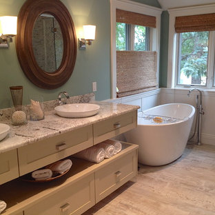 Small transitional master gray tile and marble tile gray floor bathroom photo in Detroit with shaker cabinets, beige cabinets, green walls, a vessel sink, quartzite countertops, a hinged shower door and gray countertops