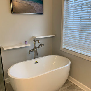 Mid-sized transitional master gray tile and porcelain tile terra-cotta tile and gray floor bathroom photo in Atlanta with shaker cabinets, white cabinets, a two-piece toilet, gray walls, an undermount sink, quartz countertops, a hinged shower door and white countertops