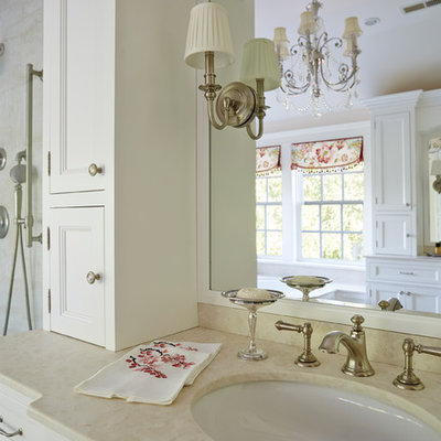 Bathroom - shabby-chic style bathroom idea in Baltimore with an undermount sink, recessed-panel cabinets, white cabinets and beige walls