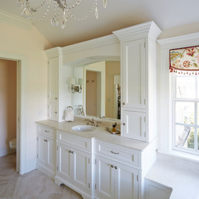 Inspiration for a shabby-chic style bathroom remodel in Baltimore with an undermount sink, recessed-panel cabinets, white cabinets and beige walls