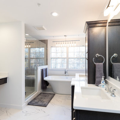 Inspiration for a mid-sized contemporary master gray tile and porcelain tile marble floor bathroom remodel in DC Metro with white walls, an undermount sink, a hinged shower door, quartz countertops, shaker cabinets, dark wood cabinets and a two-piece toilet