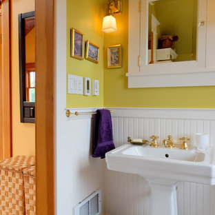 Small arts and crafts master white tile tub/shower combo photo in Seattle with a pedestal sink, a two-piece toilet and yellow walls