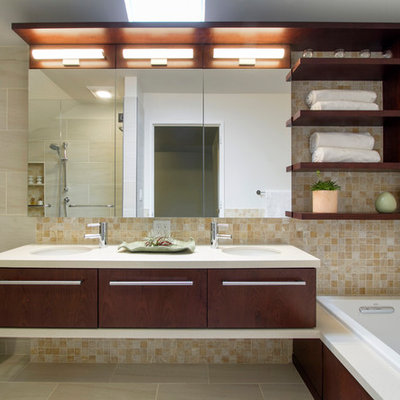 Bathroom - mid-sized modern master beige tile and porcelain tile porcelain tile and beige floor bathroom idea in New York with flat-panel cabinets, dark wood cabinets, a one-piece toilet, white walls, quartzite countertops, an undermount sink and a hinged shower door