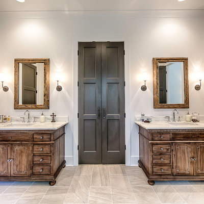 Large mountain style master beige tile and porcelain tile porcelain tile bathroom photo in Birmingham with dark wood cabinets, white walls, an undermount sink, marble countertops and recessed-panel cabinets