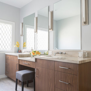 Bathroom - large contemporary master blue tile porcelain floor bathroom idea in Los Angeles with flat-panel cabinets, medium tone wood cabinets, gray walls, an undermount sink and limestone countertops