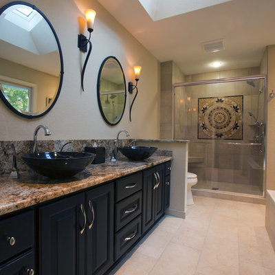 Inspiration for a contemporary bathroom remodel in Milwaukee with a vessel sink and black cabinets