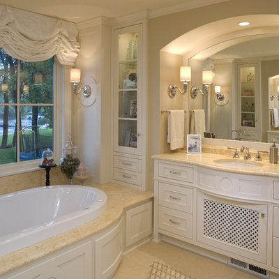 Inspiration for a large timeless master beige tile and ceramic tile ceramic tile drop-in bathtub remodel in Minneapolis with beige cabinets and granite countertops
