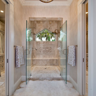 Large beach style master double shower photo in Miami