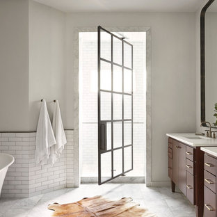 Large trendy master white tile and subway tile marble floor and white floor bathroom photo in Nashville with medium tone wood cabinets, white walls, an undermount sink, quartzite countertops and furniture-like cabinets