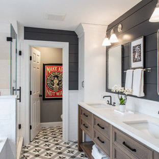 Large transitional 3/4 mosaic tile floor, multicolored floor, double-sink and shiplap wall alcove shower photo in Boston with recessed-panel cabinets, medium tone wood cabinets, black walls, an undermount sink, a hinged shower door, white countertops and a built-in vanity