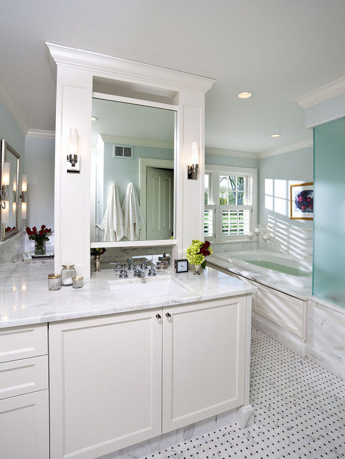 example of a trendy white tile corner shower design in minneapolis with an undermount sink