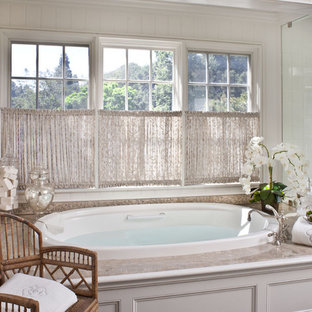 Example of a mid-sized classic master white tile drop-in bathtub design in Los Angeles with white cabinets