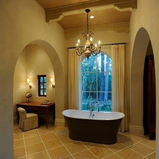 Inspiration for a large mediterranean ensuite bathroom in Other with a freestanding bath, beige tiles, beige walls and porcelain flooring.