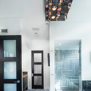Alcove shower - contemporary gray tile alcove shower idea in Salt Lake City with flat-panel cabinets
