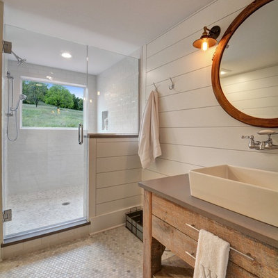 Farmhouse 3/4 white tile and subway tile mosaic tile floor and gray floor alcove shower photo in Chicago with furniture-like cabinets, medium tone wood cabinets, white walls, a vessel sink, a hinged shower door and brown countertops