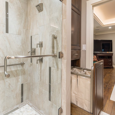 Example of a mid-sized classic master gray tile and glass tile porcelain tile bathroom design in Austin with an undermount sink, raised-panel cabinets, medium tone wood cabinets, granite countertops and beige walls
