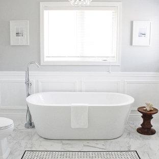 Freestanding bathtub - contemporary white tile freestanding bathtub idea in Toronto