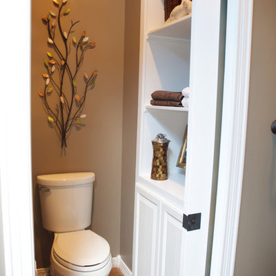 Mid-sized transitional master mosaic tile and brown tile porcelain tile bathroom photo in Other with white cabinets, an undermount sink, beige walls, raised-panel cabinets and a two-piece toilet