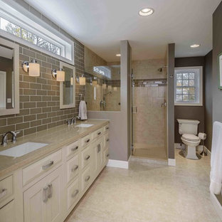 Example of a mid-sized classic master beige tile and subway tile ceramic floor and beige floor alcove shower design in Other with an undermount sink, raised-panel cabinets, beige cabinets, a two-piece toilet, gray walls and engineered quartz countertops