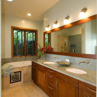 This is an example of a tropical bathroom in Hawaii with solid surface benchtops and an undermount sink.