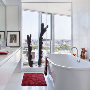 Inspiration for a contemporary white tile and mosaic tile freestanding bathtub remodel in New York with an integrated sink